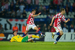 OSIJEK, CROATIA - Sunday, May 23, 2010: Wales' Mark Bradley tackles Croatia's Mate Bilic as he makes his debut during the International Friendly match at the Stadion Gradski Vrt. (Pic by David Rawcliffe/Propaganda)