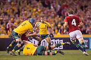Ben Youngs (Lions) is tackled hard by James Horwill (c) (Wallabies) and loses during the second test between the DHL Australian Wallabies vs HSBC British And Irish Lions at Etihad Stadium, Melbourne, Victoria, Australia. 29/06/0213. Photo By Lucas Wroe