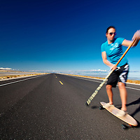 Kelsey Kooreman, Professional Triathlete paddle skateboarding