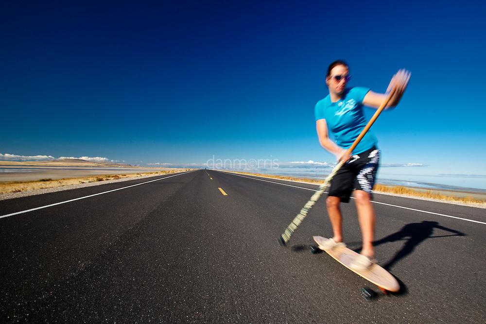 Kelsey Kooreman, Professional Triathlete paddle skateboarding