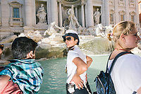 """ROME, ITALY - 20 JUNE 2017: A Roman policewoman, entrusted to protect the Fountain of Trevi, is seen here by the fountain in Rome, Italy, on June 20th 2017.<br /> <br /> The warm weather has brought a menacing whiff of tourists behaving badly in Rome. On April 12, a man went skinny-dipping in the Trevi fountain resulting in a viral web video and a 500 euro fine.<br /> <br /> Virginia Raggi, the mayor of Rome and a national figurehead of the anti-establishment Five Star Movement,  issued an ordinance involving harsher fines for eating, drinking or sitting on the fountains, for washing animals or clothes in the fountain water or for throwing anything other than coins into the water of the Trevi Fountain, Bernini's Four Fountains and 35 other city fountains of artistic or historic significance around the city.  """"It is unacceptable that someone use them to go swimming or clean themselves, it's an historic patrimony that we must safeguard,"""" Ms. Raggi said."""