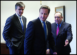 Scottish First Minister Alex Salmond meets British Prime Minister David Cameron and Michael Moore Scottish Secretary of State (LEFT) during talks on the Scottish Independence referendum in St Andrews House on February 16, 2012 in Edinburgh, Scotland. David Cameron said he would consider devolving further powers for Scotland if the Scottish people voted against independence in a referendum. Photo By Andrew Parsons/ i-Images<br />
