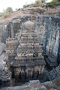 Kailasa Temple. Carved directly into a basalt rock cliff, this temple forms part of the large Ellora Caves complex, near Aurangabad, Maharashtra State, India. The temples date from 600-1000 AD, and are a mixture of religious carvings from Buddhism, Hinduism and Jainism. The basalt rock is part of the massive Deccan Traps lava flow that, around 66 million years ago, covered what is now west- central India. Photographed in 2011.