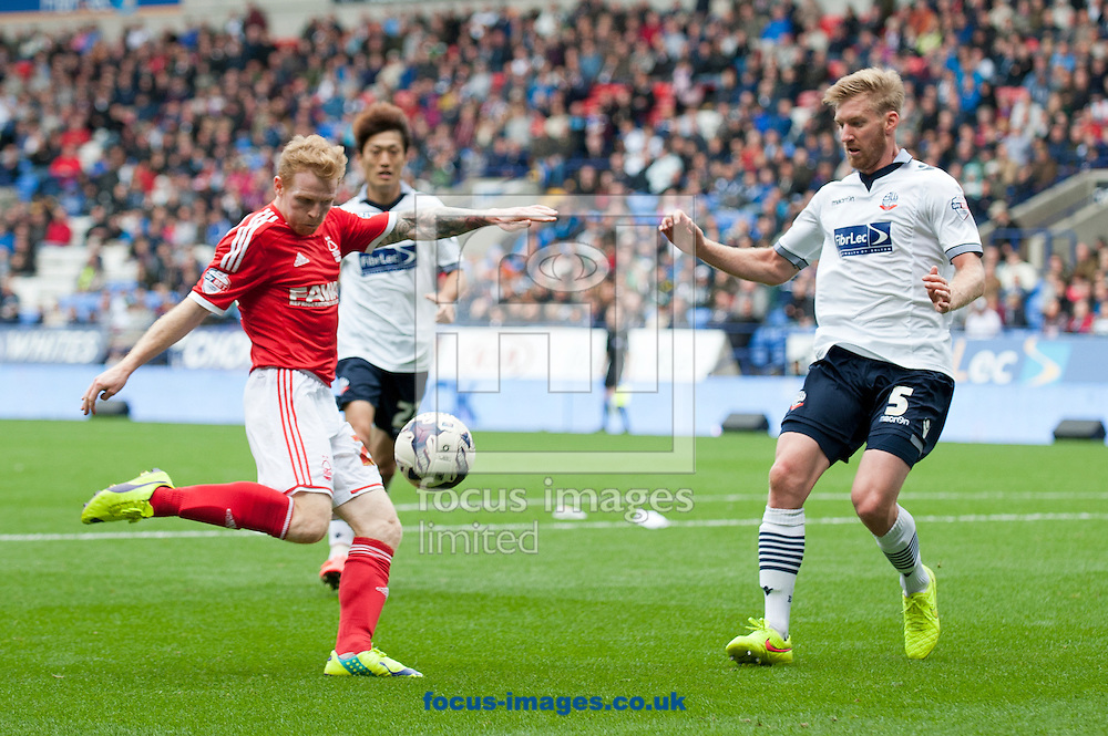 Chris Burke of Nottingham Forest looks to strike at goal during the Sky Bet Championship match at the Macron Stadium, Bolton<br /> Picture by Russell Hart/Focus Images Ltd 07791 688 420<br /> 16/08/2014