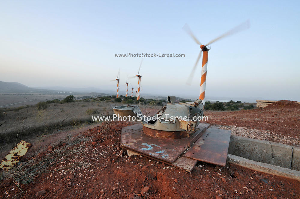Israel, Golan Heights, View of Wind turbines near kibbutz Ein Zivan, October 05, 2009, Syrian fortifications left over from the six day war in the foreground