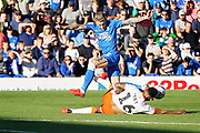 Peterborough United forward Jason Cummings (35) is tackled by Blackpool defender Curtis Tilt (16) during the EFL Sky Bet League 1 match between Peterborough United and Blackpool at The Abax Stadium, Peterborough, England on 29 September 2018.