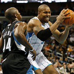 February 7, 2011; New Orleans, LA, USA; New Orleans Hornets power forward David West (30) drives in against Minnesota Timberwolves center Anthony Tolliver (44) during the second quarter at the New Orleans Arena.   Mandatory Credit: Derick E. Hingle