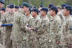 © London News Pictures. 18/04/2013. Medals are presented by Major General  T B Radford DSO OBE, General Officer Commanding Theatre Troops in Maidstone, Kent today. Around 300 members of the Operation Herrick 17 Explosive Ordnance Disposal and Search Task Force receive the Afghanistan Campaign Medal at a ceremony in Maidstone.today 18/04/13.  The ceremony took place at Invicta Park barracks, home to 36 Engineers Regiment (Search), which was the lead element in the task force.  Picture credit should read Manu Palomeque/LNP