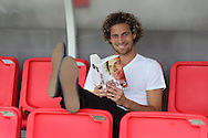 JAMES BOARDMAN / 07967642437<br /> Crawley Town's Sergio Torres with his book 'The Sergio Torres Story: From the Brick Factory to the Theatre of Dreams'. September 23, 2013.