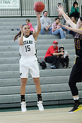 12 December 2015:  Sierra Leggett during an NCAA women's basketball game between the Wisconsin Stevens Point Pointers and the Illinois Wesleyan Titans in Shirk Center, Bloomington IL
