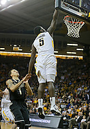 February 27 2013: Iowa Hawkeyes guard Anthony Clemmons (5) dunks the ball over Purdue Boilermakers guard Anthony Johnson (1) during the first half of the NCAA basketball game between the Purdue Boilermakers and the Iowa Hawkeyes at Carver-Hawkeye Arena in Iowa City, Iowa on Wednesday, February 27 2013.