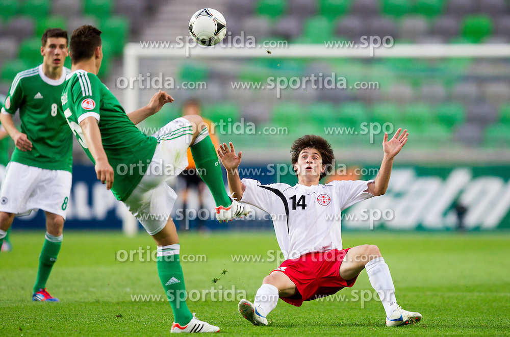 Niklas Suele of Germany vs Davit Jikia of Georgia during the UEFA European Under-17 Championship Group A match between Georgia and Germany on May 4, 2012 in SRC Stozice, Ljubljana, Slovenia. Germany defeated Georgia 1-0. (Photo by Vid Ponikvar / Sportida.com)