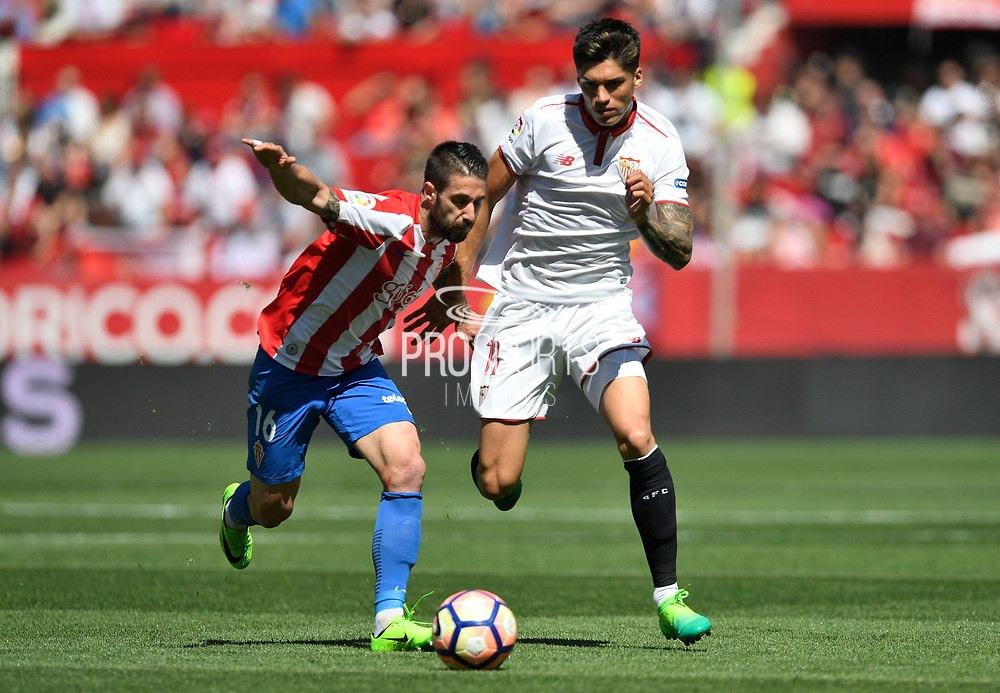 Lillo of Sporting Gijon in duel with Carlos Joaquin Correa of Sevilla FC during the Spanish championship Liga football match between Sevilla FC and Sporting Gijon on April 2, 2017 at Sanchez Pizjuan stadium in Sevilla, Spain - photo Cristobal Duenas / Spain / ProSportsImages / DPPI