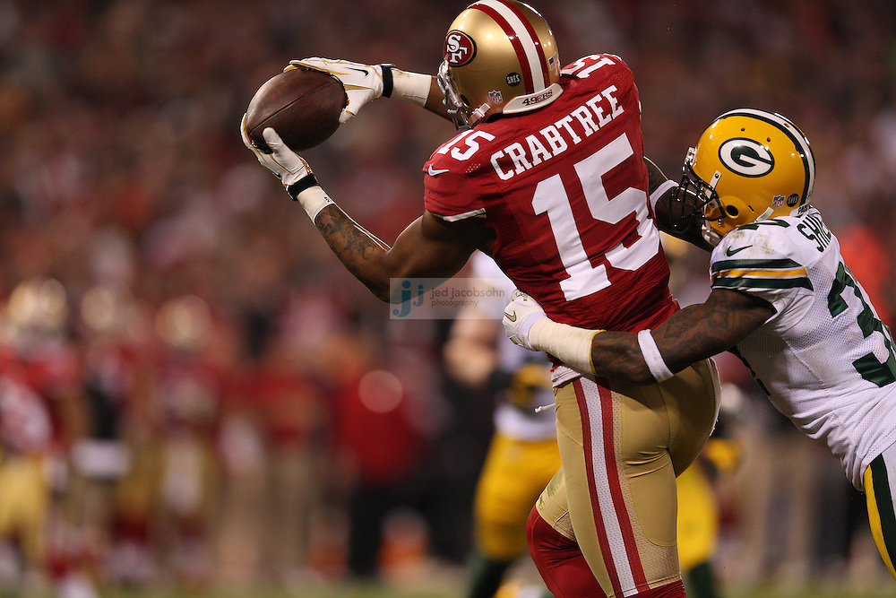 San Francisco 49ers wide receiver Michael Crabtree (15) catches a touchdown against Green Bay Packers cornerback Sam Shields (37) during a NFL Divisional playoff game at Candlestick Park in San Francisco, Calif., on Jan. 12, 2013. The 49ers defeated the Packers 45-31. (AP Photo/Jed Jacobsohn)