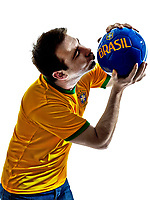 one man with Brazilian jersey kissing soccer ball isolated in white background