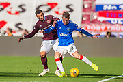 Steven Davis (#10) of Rangers FC shields the ball from Jake Mulraney (#11) of Heart of Midlothian FC during the Ladbrokes Scottish Premiership match between Heart of Midlothian and Rangers FC at Tynecastle Park, Edinburgh, Scotland on 20 October 2019.