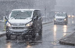 © Licensed to London News Pictures. 27/02/2018. London, UK. Traffic in heavy snowfall near St Paul's Cathedral in the City of London, as a cold front, named the 'Beast From the East' hits the capital. Amber weather warnings are in place for large parts of the east of the UK as a severe cold front heads in from Russia. Photo credit: Ben Cawthra/LNP