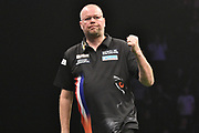 Raymond van Barneveld wins a leg during the Betway Premier League Darts at the Manchester Arena, Manchester, United Kingdom on 23 March 2017. Photo by Mark Pollitt.