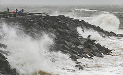 © Licensed to London News Pictures. 03/03/2019. West Bay, UK. People walking on the seafront at West Bay in Dorset feel the force of storm Freya as winds and rain hit the coast. Photo credit: Jason Bryant/LNP