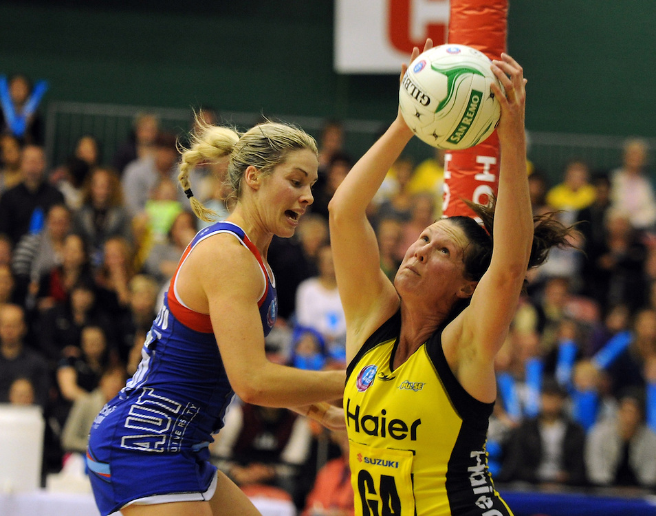 Pulse's Donna Wilkins, left, takes the ball infront of Mystics' Julie Corletto in the ANZ Championship netball, Arena Manawatu, Palmerston North, New Zealand, Sunday, May 18, 2014. Credit:SNPA / Ross Setford