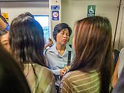 12 DECEMBER 2013 - BANGKOK, THAILAND:   Commuters on the Sukhumvit line of the BTS Skytrain in Bangkok.    PHOTO BY JACK KURTZ