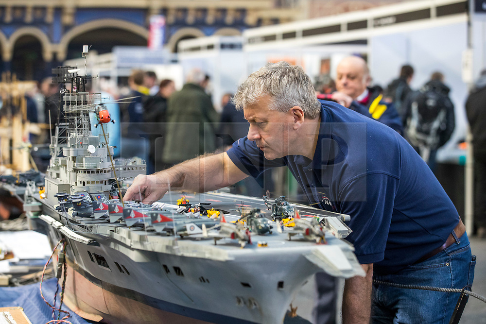 19/01/2018. London, UK. Dave Fortey tends to his model of HMS Ark Royal (R09) at the London Model Engineering Exhibition at Alexandra Palace. Fortey, a former Royal Navy mechanic and sub-lieutenant, built the model over 25 years. It is the first time it has been put on display to the public. Photo credit: Rob Pinney