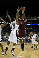 Virginia Tech Hokies guard Zabian Dowdell (1) shoots over Southern Illinois Salukis guard Tony Young (15).  The #4 seed Southern Illinois Salukis defeated the #5 seed Virginia Tech Hokies 63-48 in the second round of the Men's NCAA Basketball Tournament at the Nationwide Arena in Columbus, OH on March 18, 2007.
