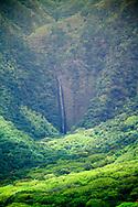 MOLOKAI, HI - Hipuapua falls in Halawa valley on the Pacific island of Molokai, Hawaii.  The waterfall is a popular tourist destination on the island.