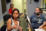 Windsor, Canada, 2014. Two students in Mireille Coral's(background) adult high school class record an interview at University of Windsor CJAM radio for an upcoming communuity news program.