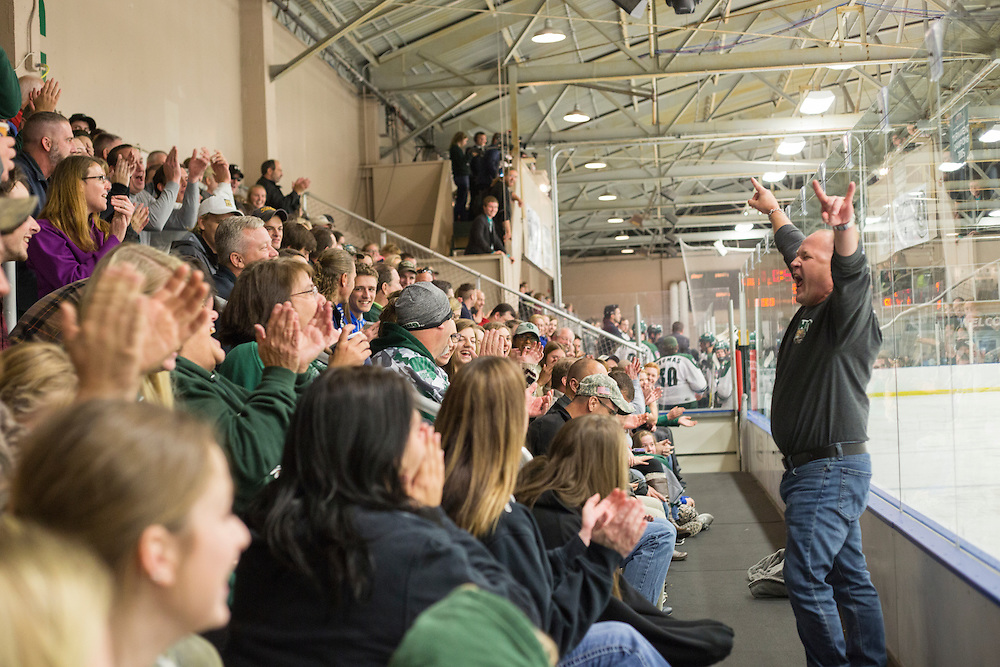 Mike Shuba, of Cleveland, cheers in front of the crowd during the Ohio University vs. University of Michigan - Dearborn hockey game during Dad's Weekend on November 5, 2016. Shuba won the first ever Fan of the Game for his enthusiasm.