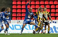 28.06.2006, Ratina, Tampere, Finland..Veikkausliiga 2006 - Finnish League 2006.Tampere United - FC Honka.John Weckström (Honka) v Ville Lehtinen (TamU), ja Ratinan tyhjät kuppi-istuimet..©Juha Tamminen.....ARK:k