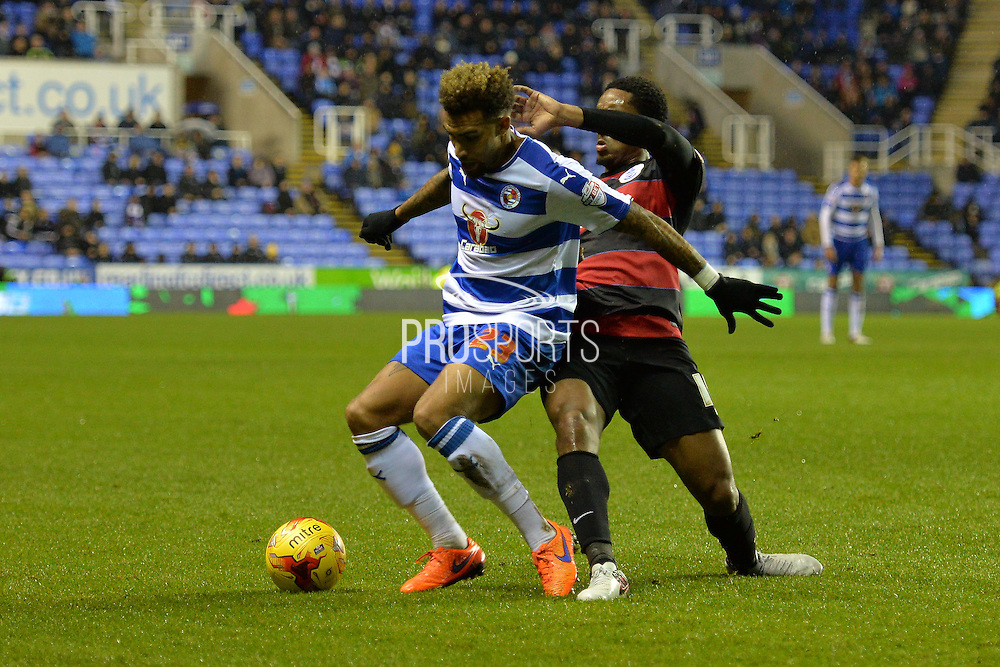 Reading's Danny Williams holds off Queens Park Rangers midfielder Leroy Fer during the Sky Bet Championship match between Reading and Queens Park Rangers at the Madejski Stadium, Reading, England on 3 December 2015. Photo by Mark Davies.