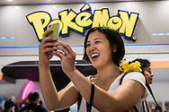 A girl with a Pikachu on her shoulder plays Pokemon go in front of the Pokemon center in Ikebukuro. The Japanese version of the game app Pokemon Go was released on July 22, 2016. Japan McDonalds' 3,000 restaurants in Japan will be turned into Pokemon gyms in collaboration with the fast-food chain. 22/07/2016-Tokyo, JAPAN