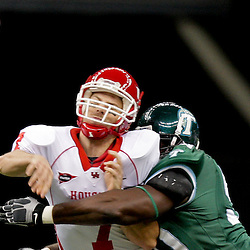 Oct 17, 2009; New Orleans, LA, USA; Tulane Green Wave safety Peter Morreale (30) hits Houston Cougars quarterback Case Keenum (7) as he attempts a pass during the first half at the Louisiana Superdome. Mandatory Credit: Derick E. Hingle-US PRESSWIRE