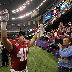 Jan 9, 2012; New Orleans, LA, USA; Alabama Crimson Tide linebacker DeMarcus DuBose (40) walks off the field after defeating the LSU Tigers 21-0 in the 2012 BCS National Championship game at the Mercedes-Benz Superdome.  Mandatory Credit: Derick E. Hingle-US PRESSWIRE