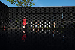 © Licensed to London News Pictures. 11/06/2018. London, UK. A visitor poses inside the Serpentine Summer Pavilion for 2018 designed by artist FRIDA ESCOBEDO in Hyde Park. Photo credit: Ray Tang/LNP