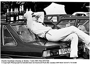 Charles Stanhope relaxing at Henley. 7 july 1985. Film 85537f20<br />