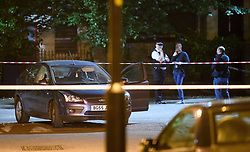 © Licensed to London News Pictures. 02/06/2018. London, UK. A car with a hole in the window at The scene where a man has reportedly been shot in the face in Peckham, south London. Police said a man was found with gunshot injuries and has been rushed to hospital. Another man was also found injured nearby. Photo credit: Ben Cawthra/LNP