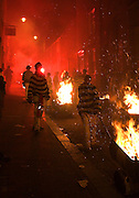 Bonfire society members with tar barrel on the streets of Lewes during late night parade 5/11/05