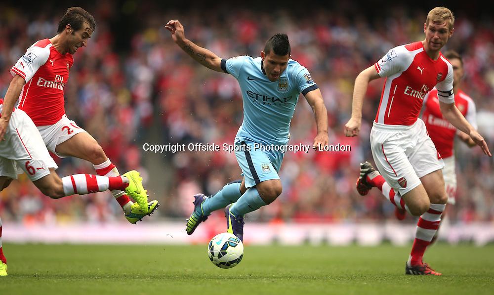 13 September 2014 , Premier League ,  Football Arsenal v Manchester City - Sergio Aguero of City runs at the Arsenal defence.<br /> Photo: Mark Leech