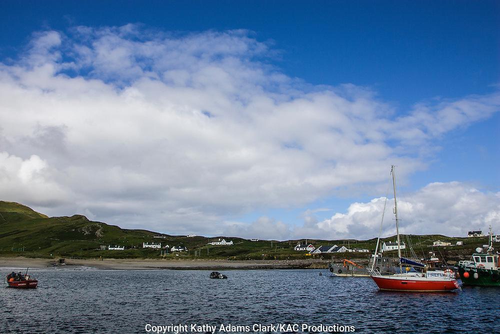 Boats in harbor on coastline of Clare Island off coast of western Ireland.