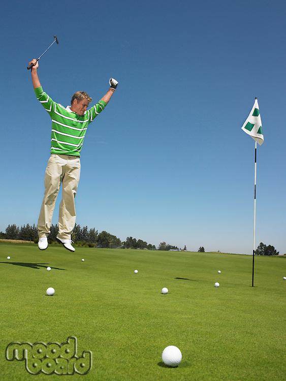 Golfer Cheering on Putting Green
