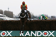 Winner Might Bite and Nico de Boinville clear the last fence in The Betway Bowl Steeple Chase Race at Aintree, Liverpool, United Kingdom on 12 April 2018. Picture by Craig Galloway.
