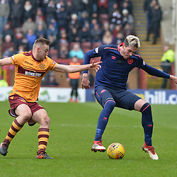 Allan Campbell (Motherwell) and Kyle Lafferty (Hearts) during the Scottish Cup quarter final between Motherwell and Hearts at Fir Park, where the home side made it into the semi final draw with a win.<br /> <br /> <br /> (c) Dave Johnston | sportPix.org.uk