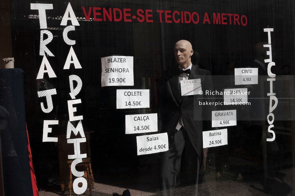 Shop window for an academic and miscellaneous clothing business in Porto, Portugal.