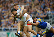 Joel Moon,Ryan Hall and Liam Sutcliffe of Leeds Rhinos tackle David Fifita (C) of Wakefield Trinity during the Betfred Super League match at Emerald Headingley Stadium, Leeds<br /> Picture by Stephen Gaunt/Focus Images Ltd +447904 833202<br /> 13/07/2018