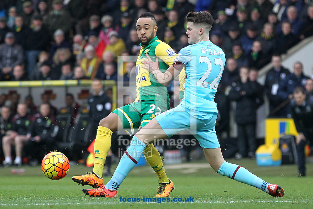 Nathan Redmond of Norwich and Sam Byram of West Ham in action during the Barclays Premier League match at Carrow Road, Norwich<br /> Picture by Paul Chesterton/Focus Images Ltd +44 7904 640267<br /> 13/02/2016