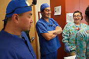 Peter Chiang, D.D.S., left, and Kenji Saisho, M.D., D.D.S., chat with Cindy Lopez, R.D.A, right, Tuesday, Dec. 13, 2011, at Central Coast Pediatric Dental Group in Salinas, California.