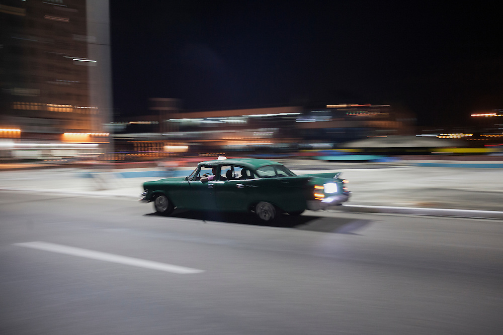 Taxi cruising the steers of Havana at night.