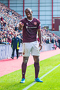 Uche Ikpeazu (#19) of Heart of Midlothian FC smiles as he pleads with the assistant referee during the Ladbrokes Scottish Premiership match between Heart of Midlothian and Rangers FC at Tynecastle Park, Edinburgh, Scotland on 20 October 2019.